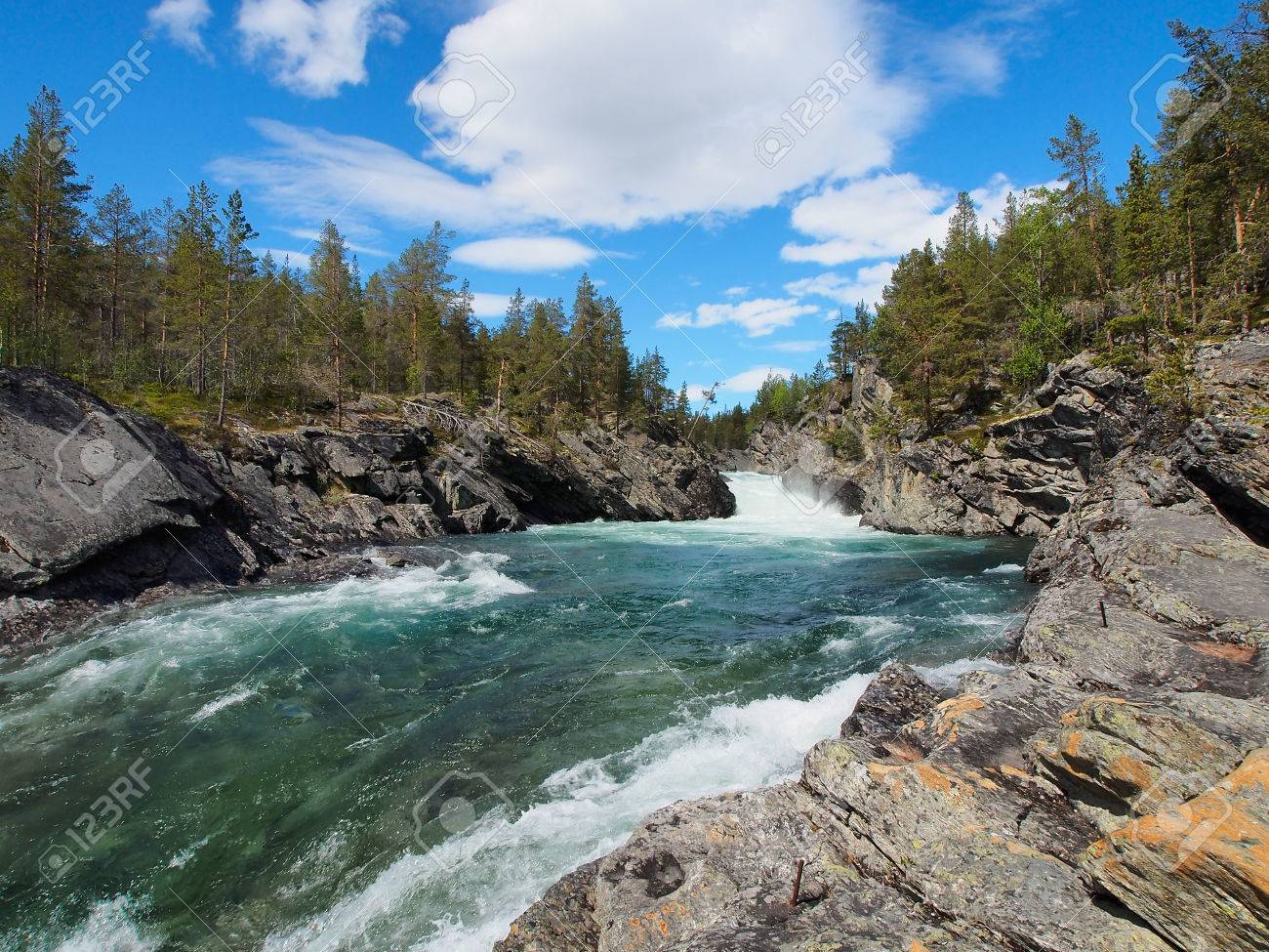 The rapidly flowing river winding through mountains, beautiful canyon in Norway, summer, sunny day - 70748339