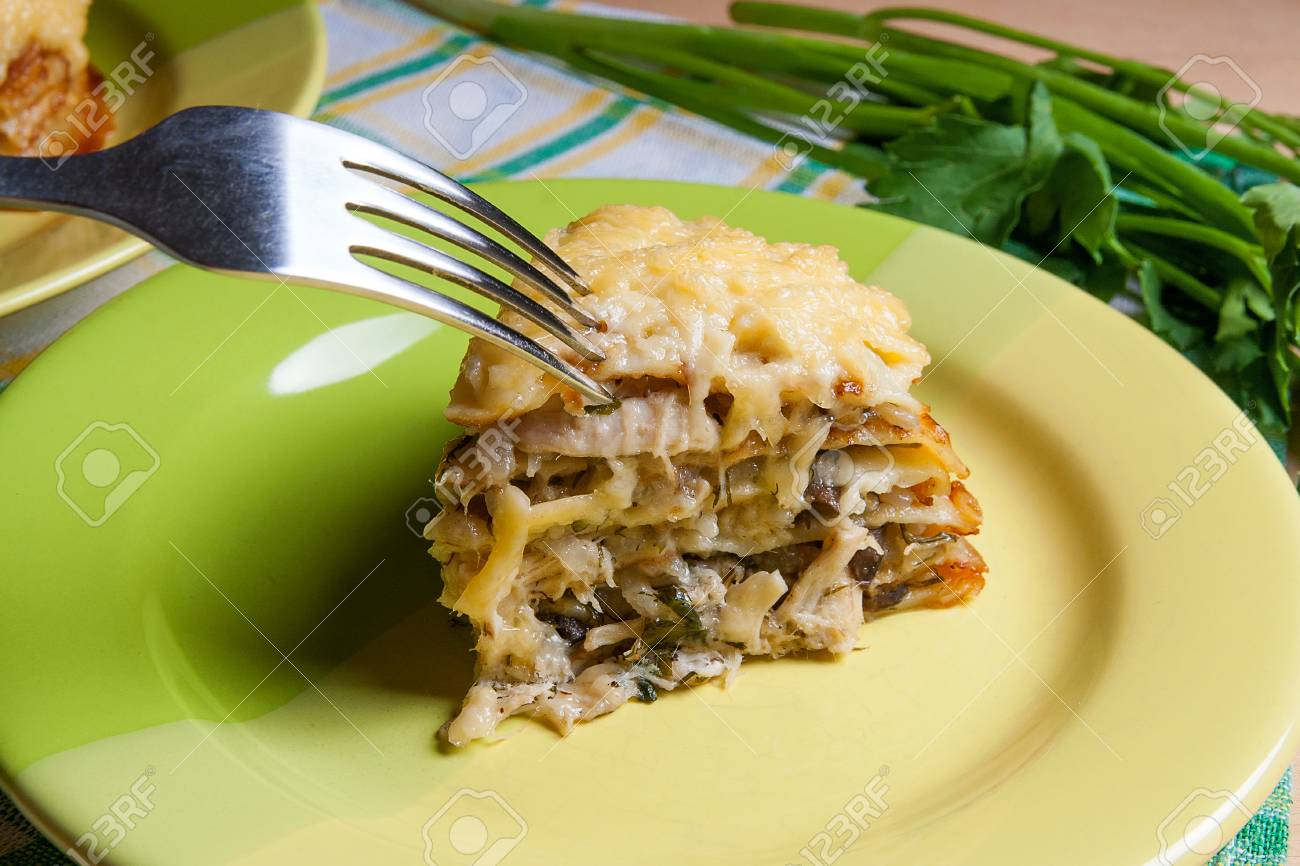Pancake pie with mushrooms and chicken meat baked with cheese on green plate. Piece & Pancake Pie With Mushrooms And Chicken Meat Baked With Cheese ...
