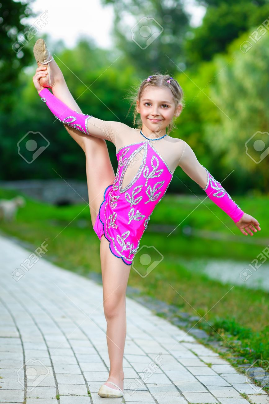 Image of flexible little girl doing gymnastics vertical split