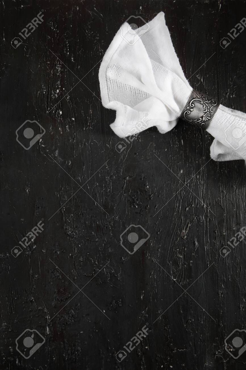The White Cloth Napkin Is Folded And Secured With An Antique Stock Photo Picture And Royalty Free Image Image 146515514