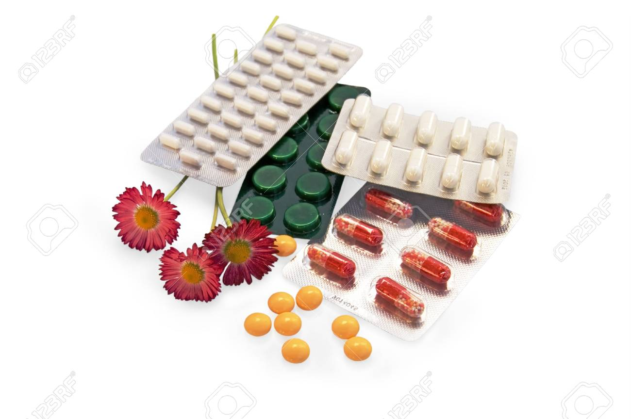 The set of tablets and capsules with red daisies on a white background Stock Photo - 7267529