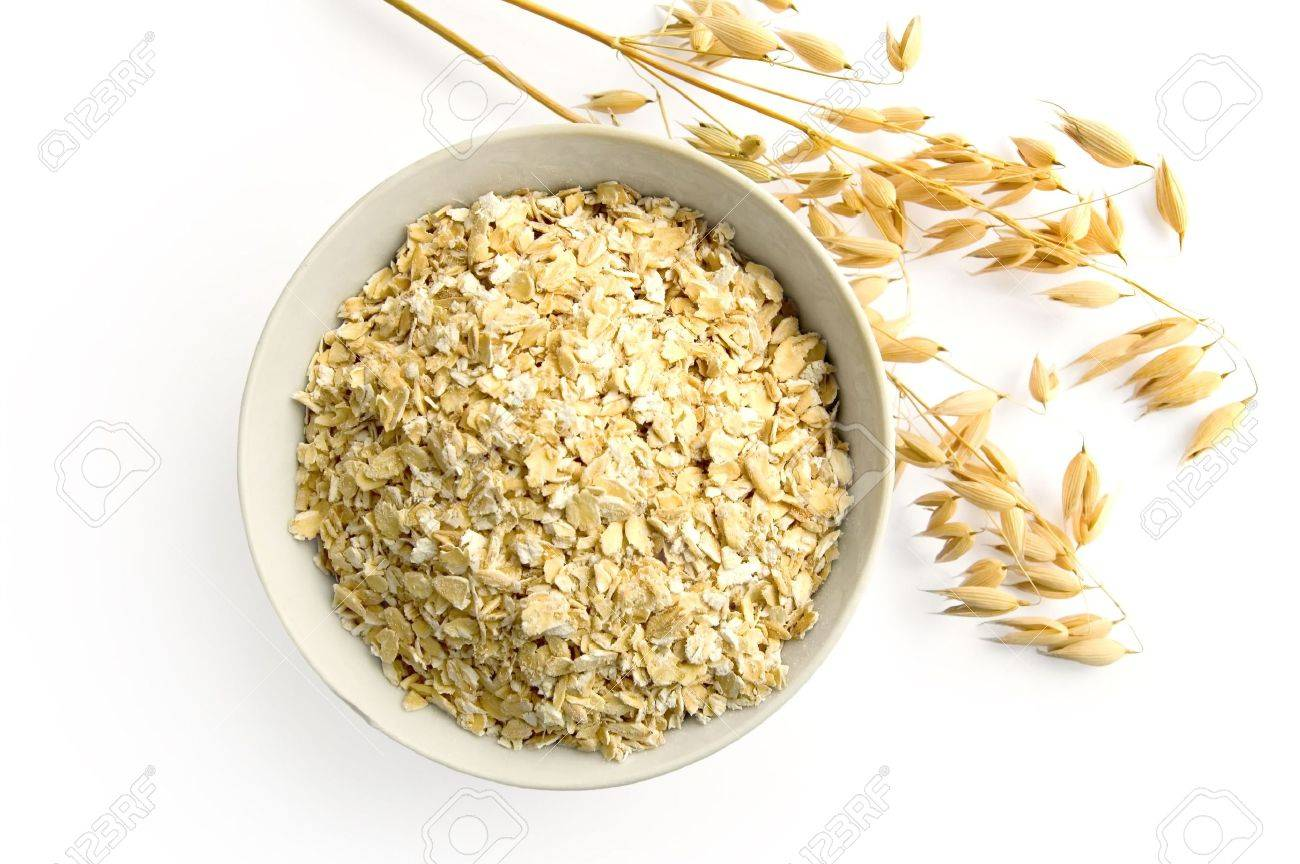 Rolled oats in a bowl, ripe stalks of oats isolated on a white background Stock Photo - 7590622
