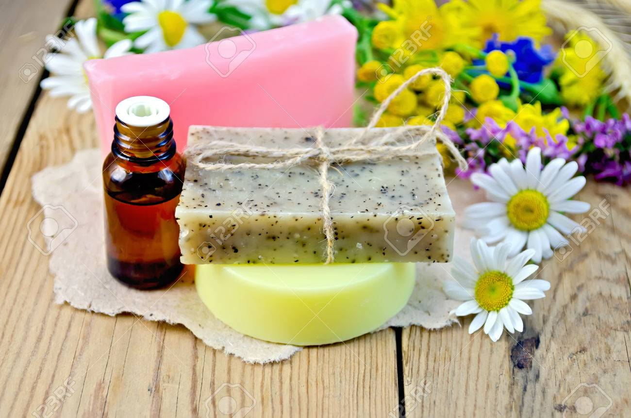 oil in a bottle homemade soap on a piece of paper chamomile