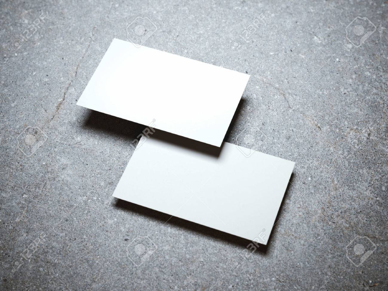 Two Blank White Business Cards On The Concrete Floor Stock Photo ...