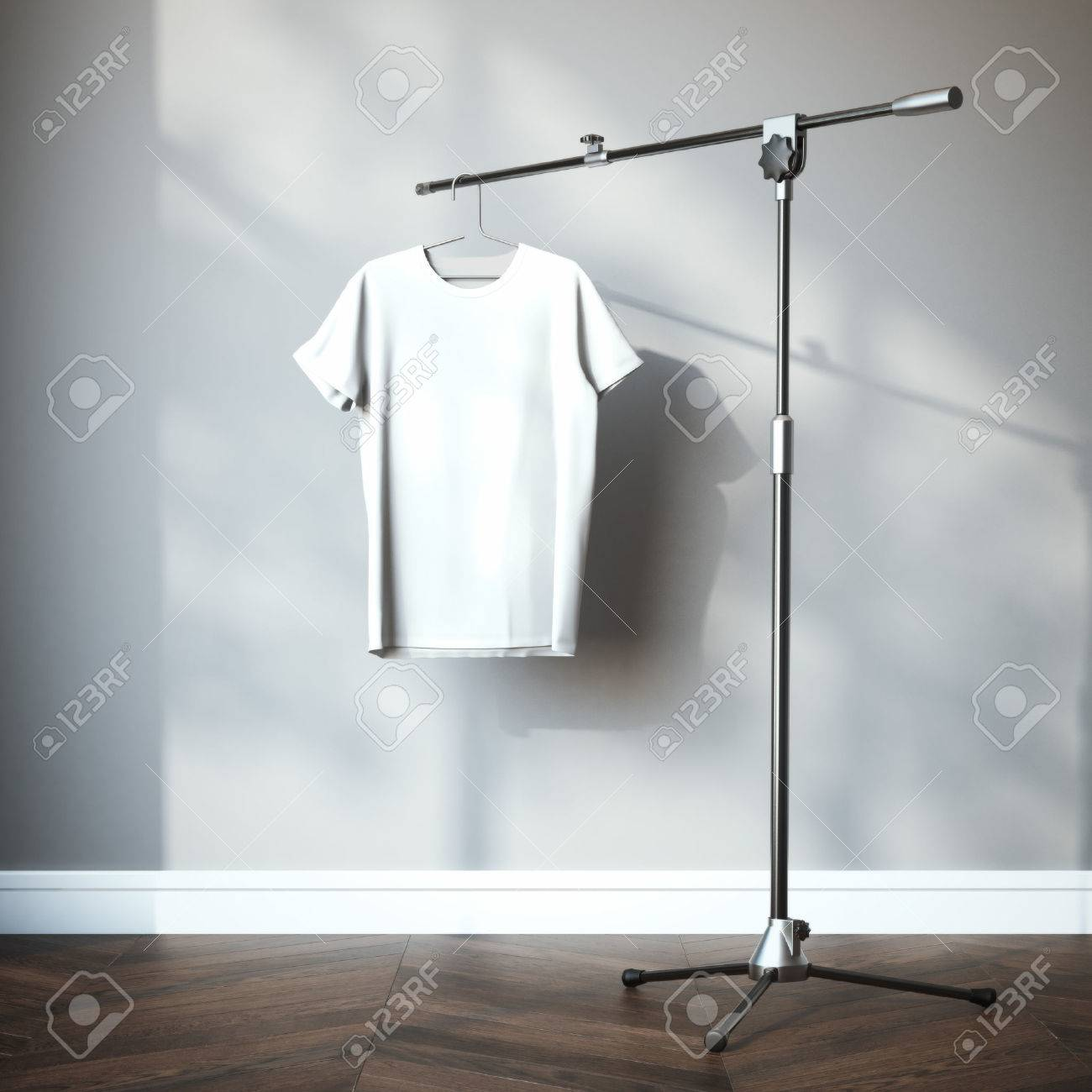 White t-shirt hanging on the tripod stand. 3d rendering - 47062979