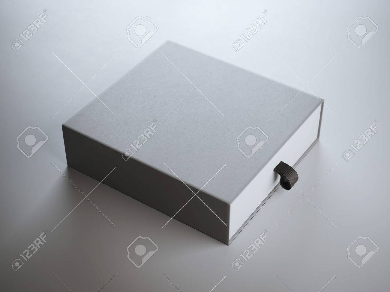 Square gray box in the white studio - 47062950