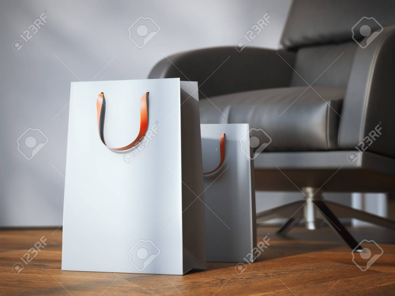 Two shopping bags near modern black armchair on the wooden floor. 3d rendering - 52413664