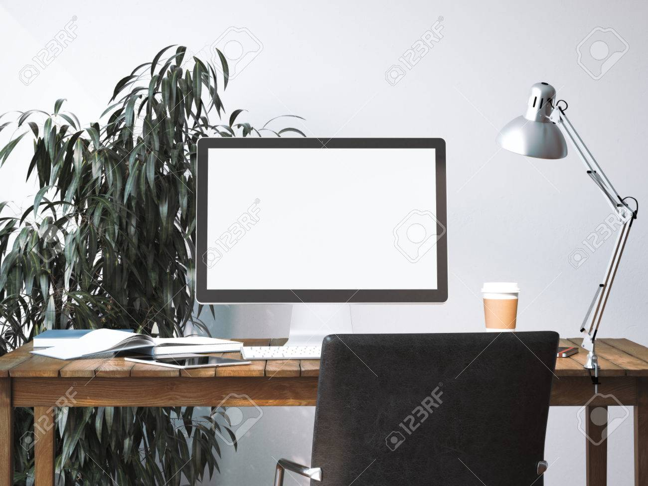 Workspace with blank screen on a wooden table. 3d rendering - 62488631