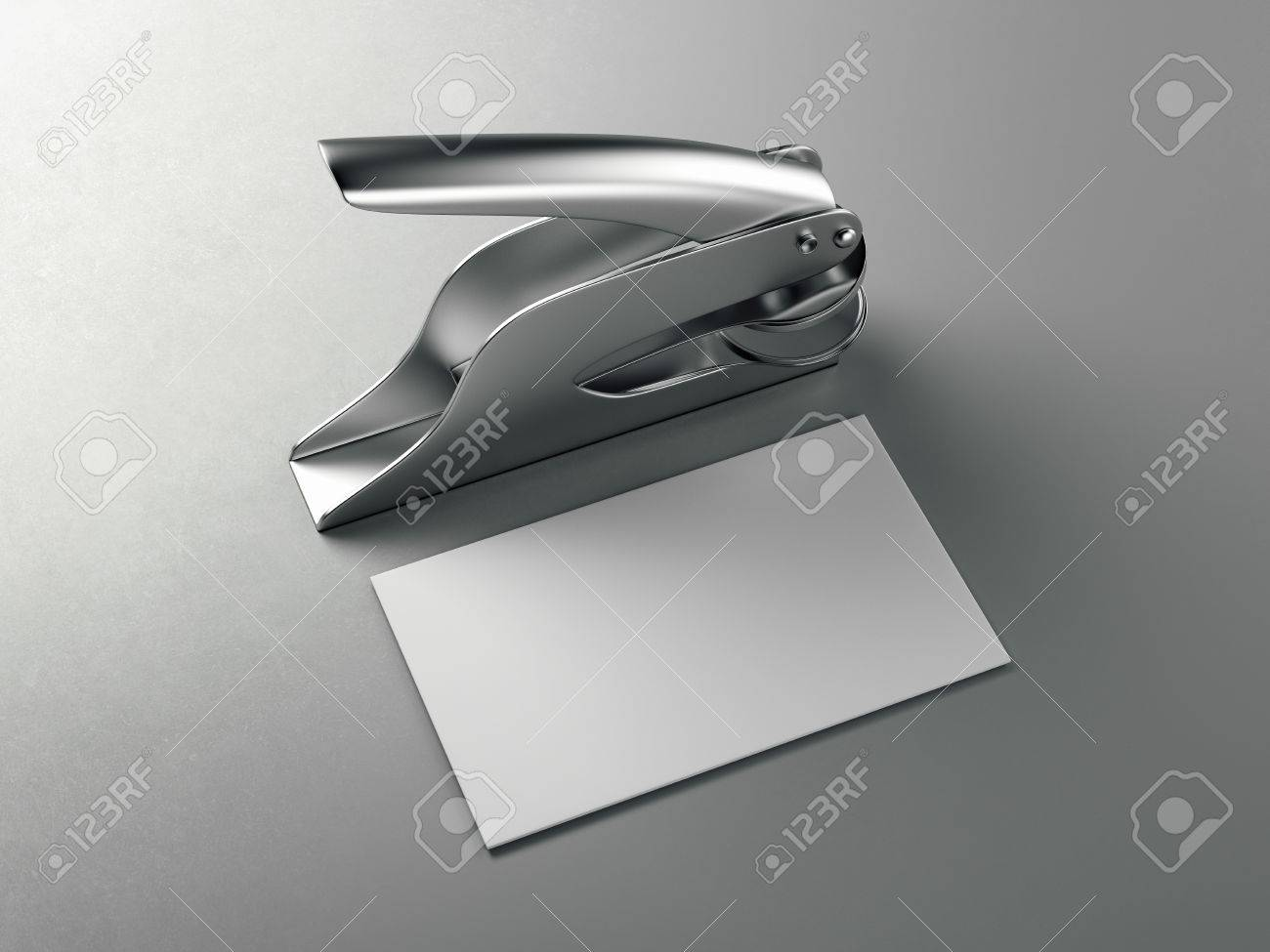 Metal Embosser With White Business Card On Gray Floor. 3d ...
