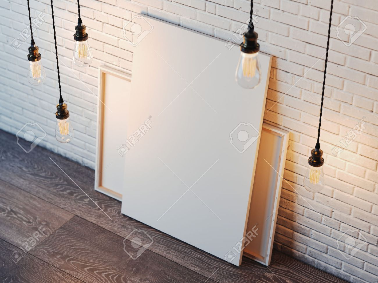 Blank white canvas with glowing bulbs in the modern loft interior with brick wall. 3d rendering - 65666374