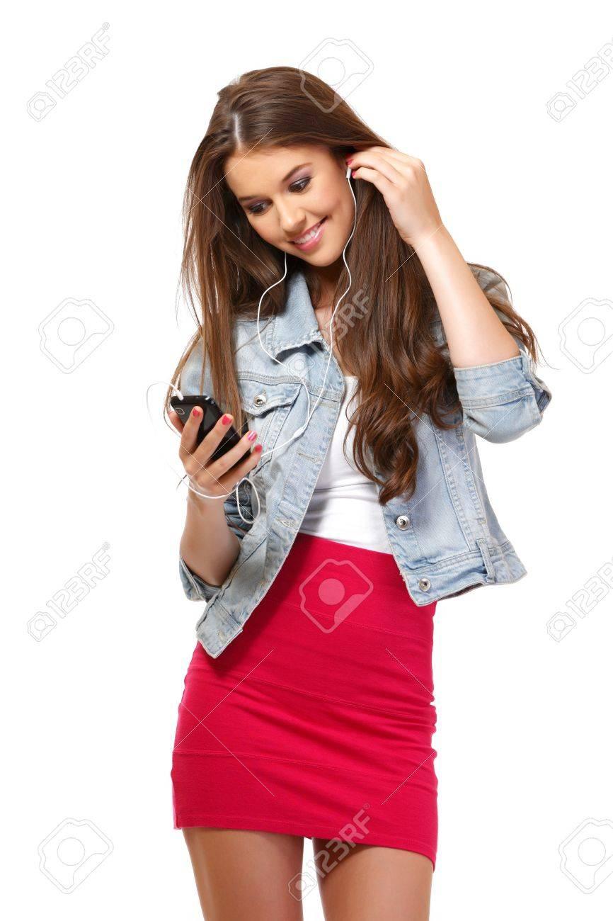 happy young woman speaking on earphone Stock Photo - 14724280
