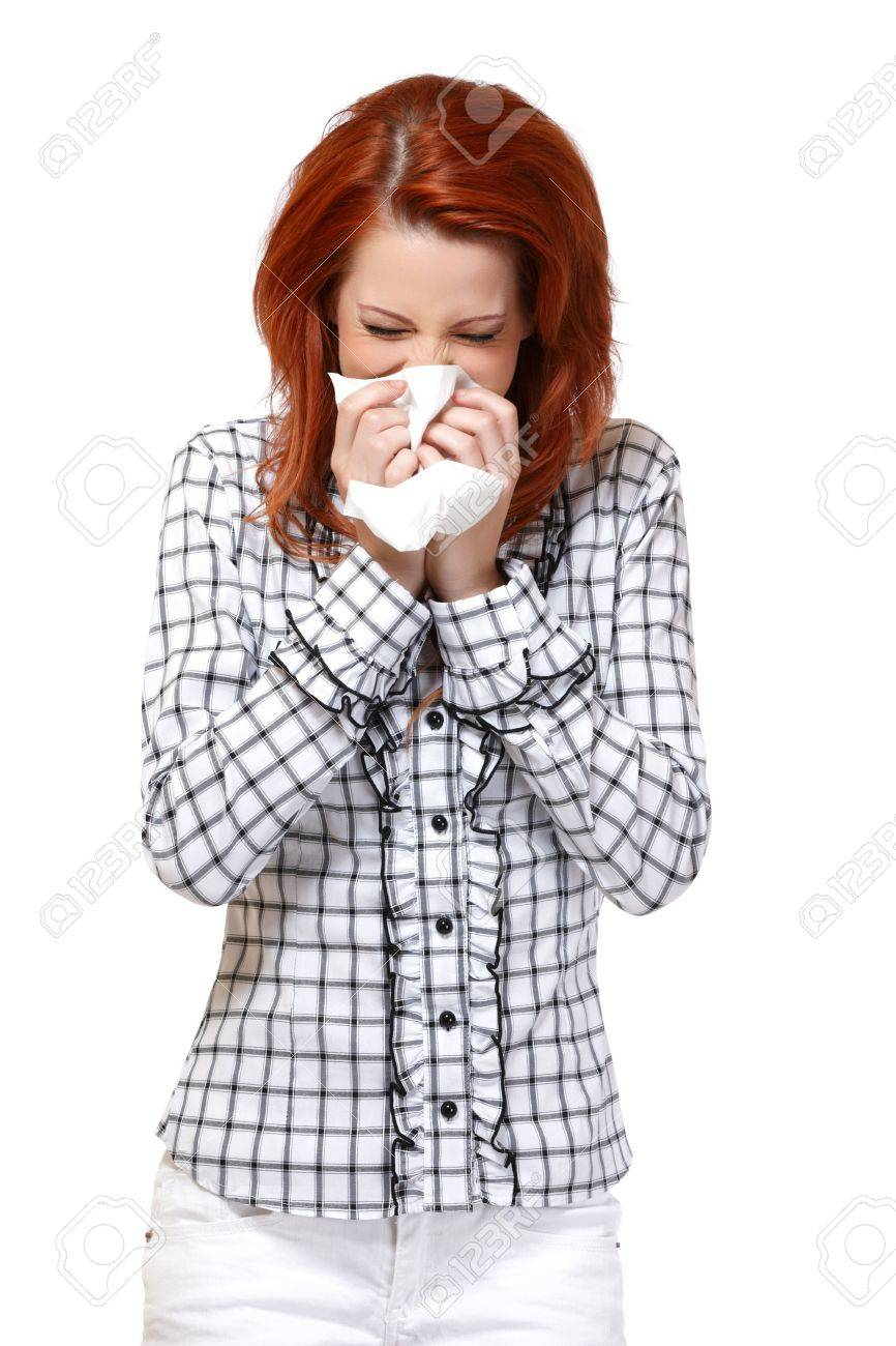 woman blowing her nose isolated on white Stock Photo - 14724825