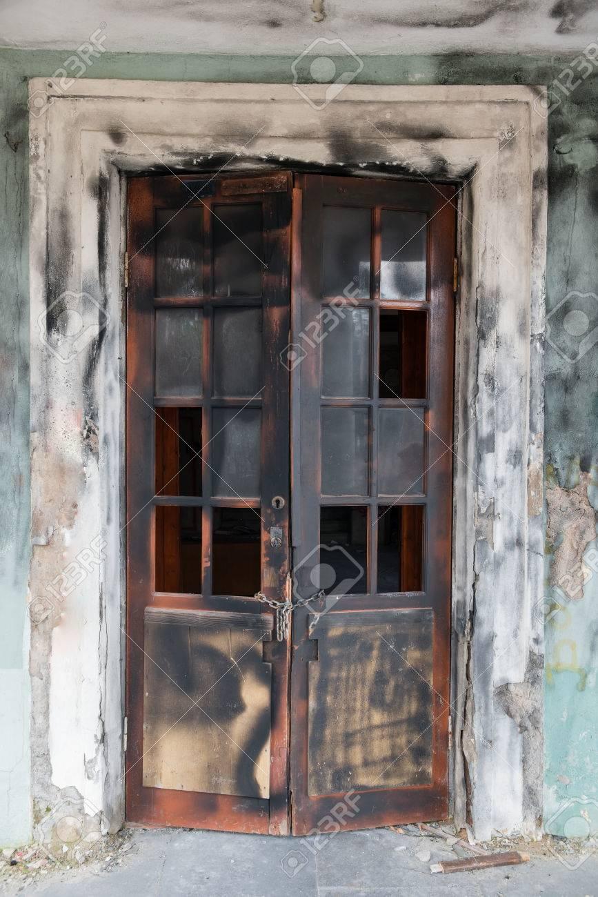 Scorched Broken Door Of Abandoned House Stock Photo   59787737