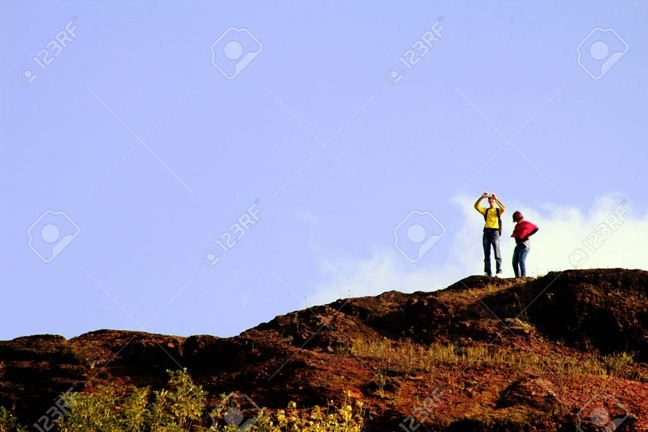 man and women on top of the mountain Stock Photo - 15623544