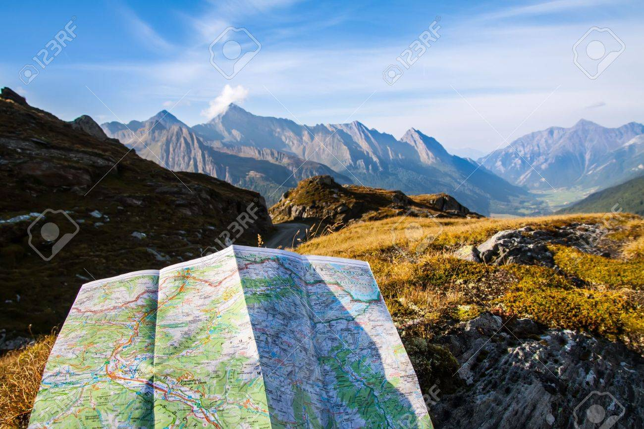 Stock Photo   Touristic Map On Alps Mountain Background