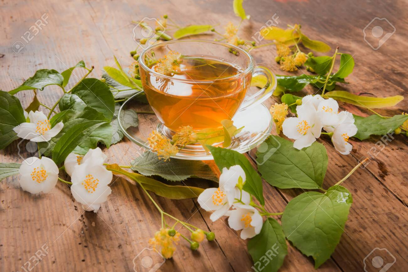 Cup of green tea linden jasmine on wooden background - 122410090