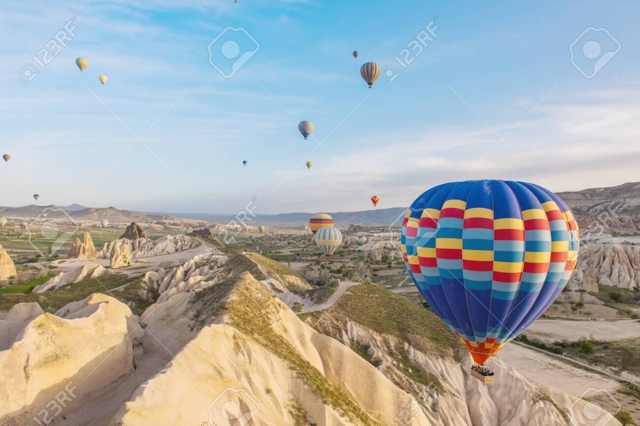 Hot air balloon flying over Cappadocia region, Turkey - 131878497