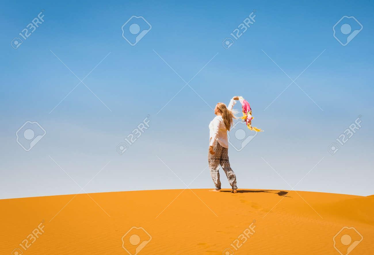 Sporty woman in Merzouga dunes of Sahara desert Morocco - 166519267