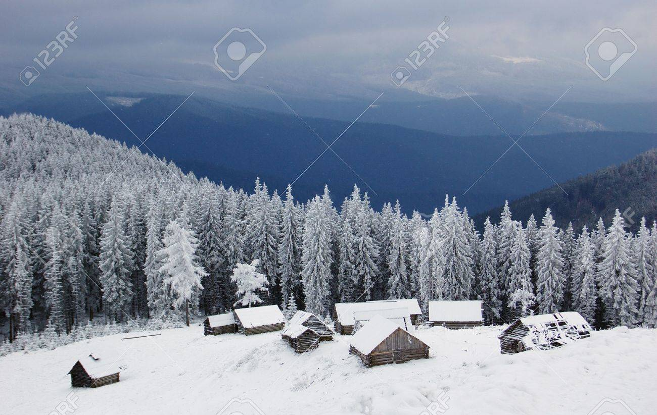 Winter landscape in mountains Carpathians, Ukraine and a valley with huts Stock Photo - 6686780