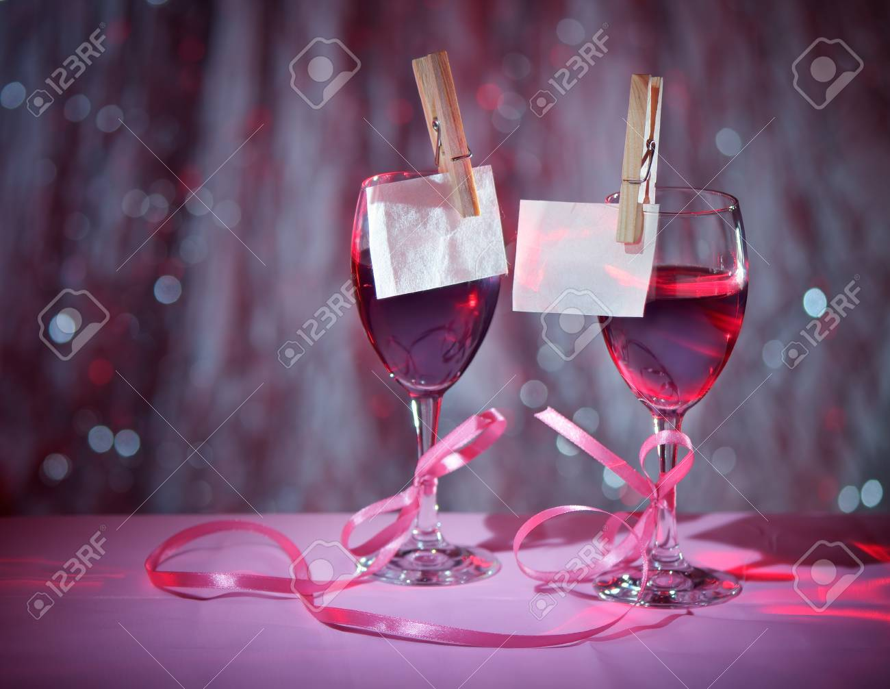Glasses of red wine associated with tape  Design on the theme of love Stock Photo - 17108865