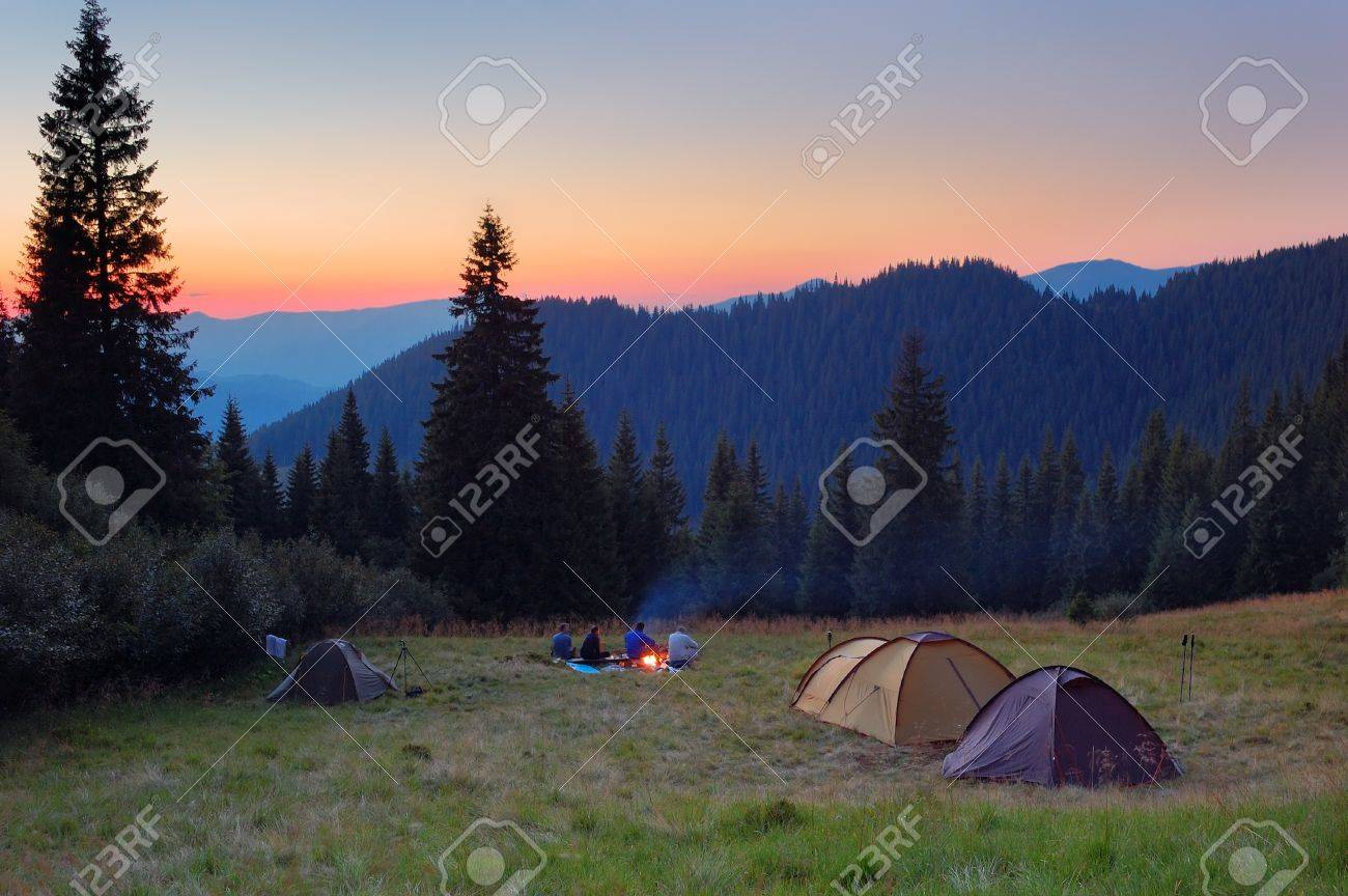 Evening by the fire in the mountains C&ing in tents in the mountains Stock Photo - & Evening By The Fire In The Mountains Camping In Tents In The ...