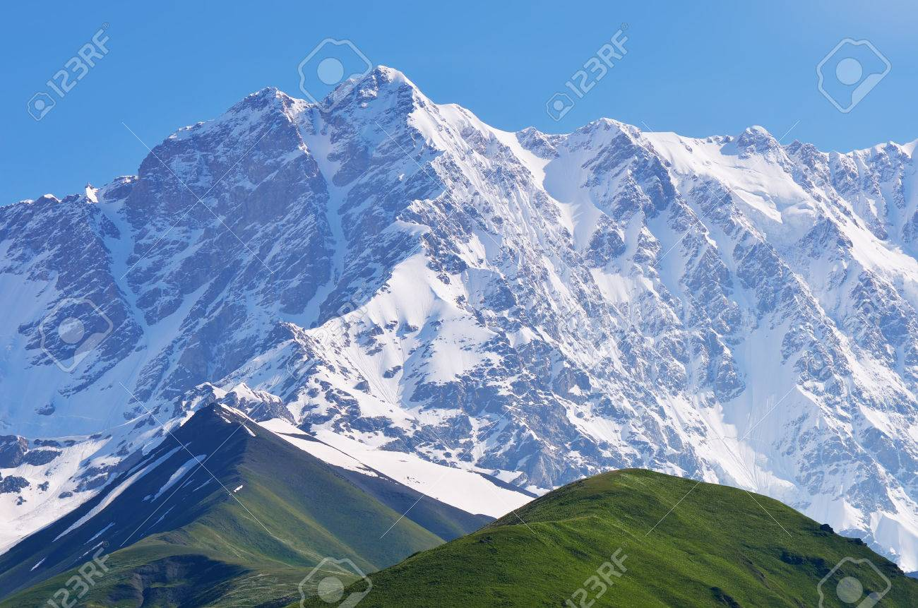 Mountain landscape with snow covered peak shkhara mountain mountain landscape with snow covered peak shkhara mountain georgia greater caucasus range stock sciox Gallery