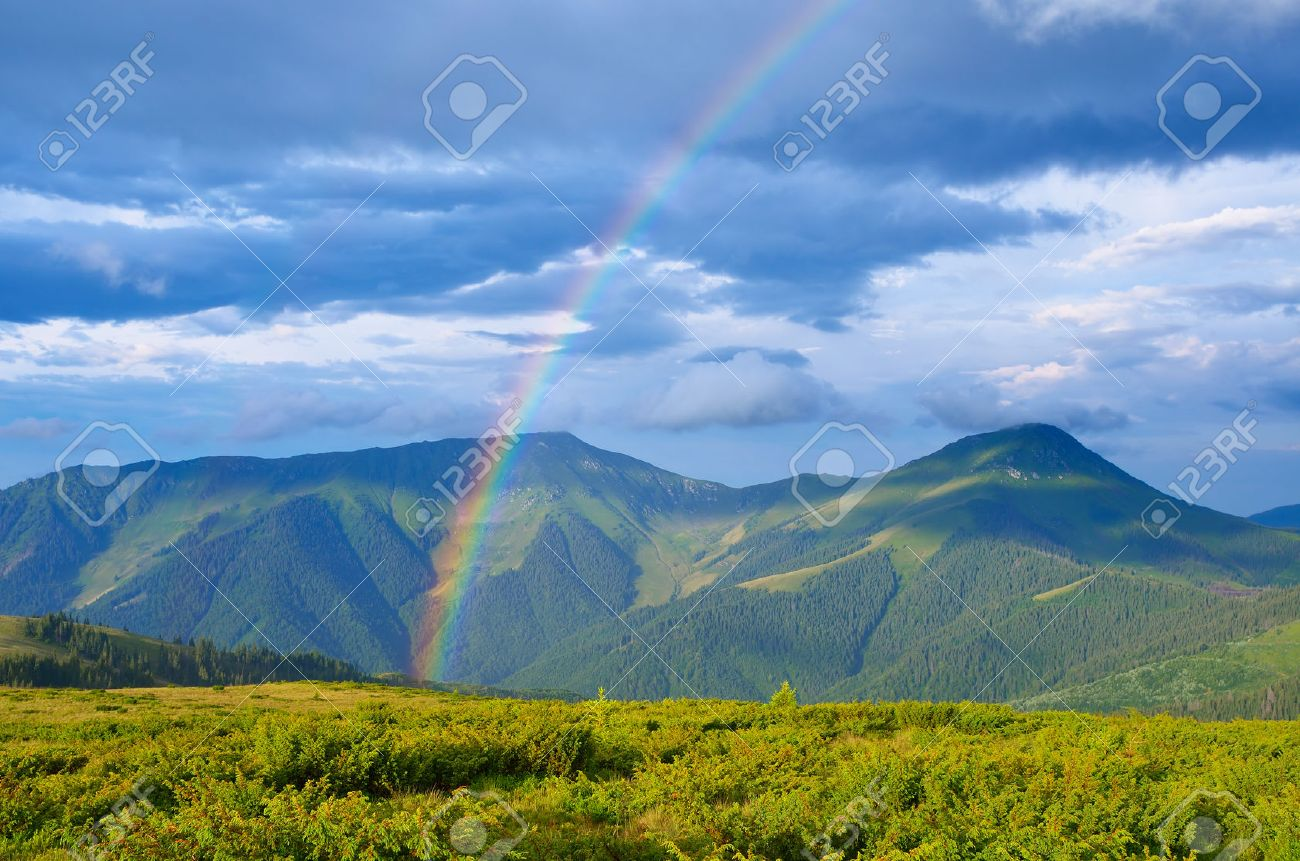 Summer landscape with a rainbow in the mountains Sunshine after the rain Beauty in nature - 30606251