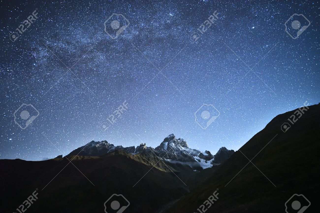 Night landscape. Starry sky with the Milky Way over the mountains. Mount Ushba in the light of the rising moon. Main Caucasian ridge. Zemo Svaneti, Georgia Stock Photo - 48209861