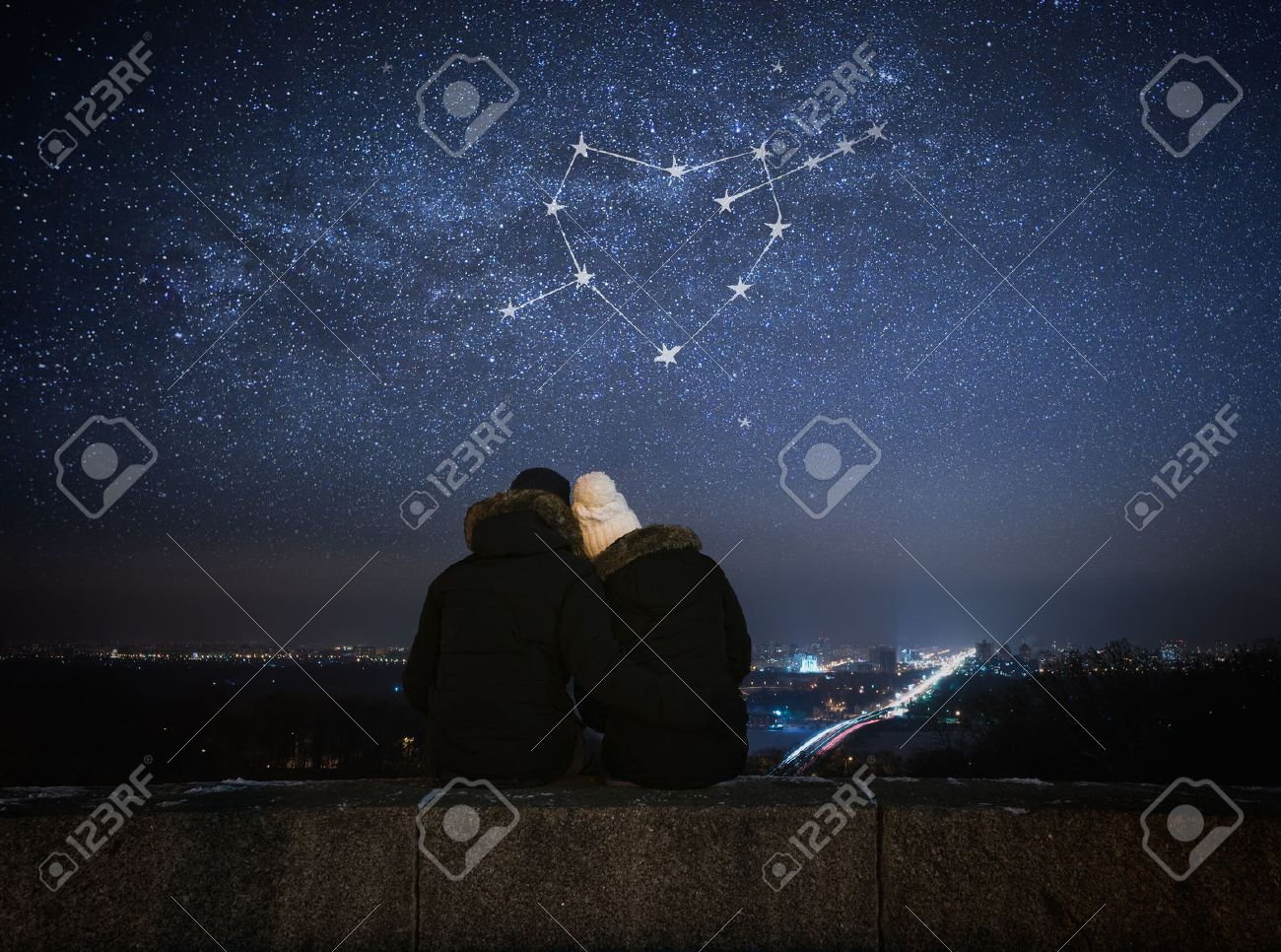Valentines Day card. Couple in love looking at stars. Night in city. Constellation in shape of a heart - 50843191