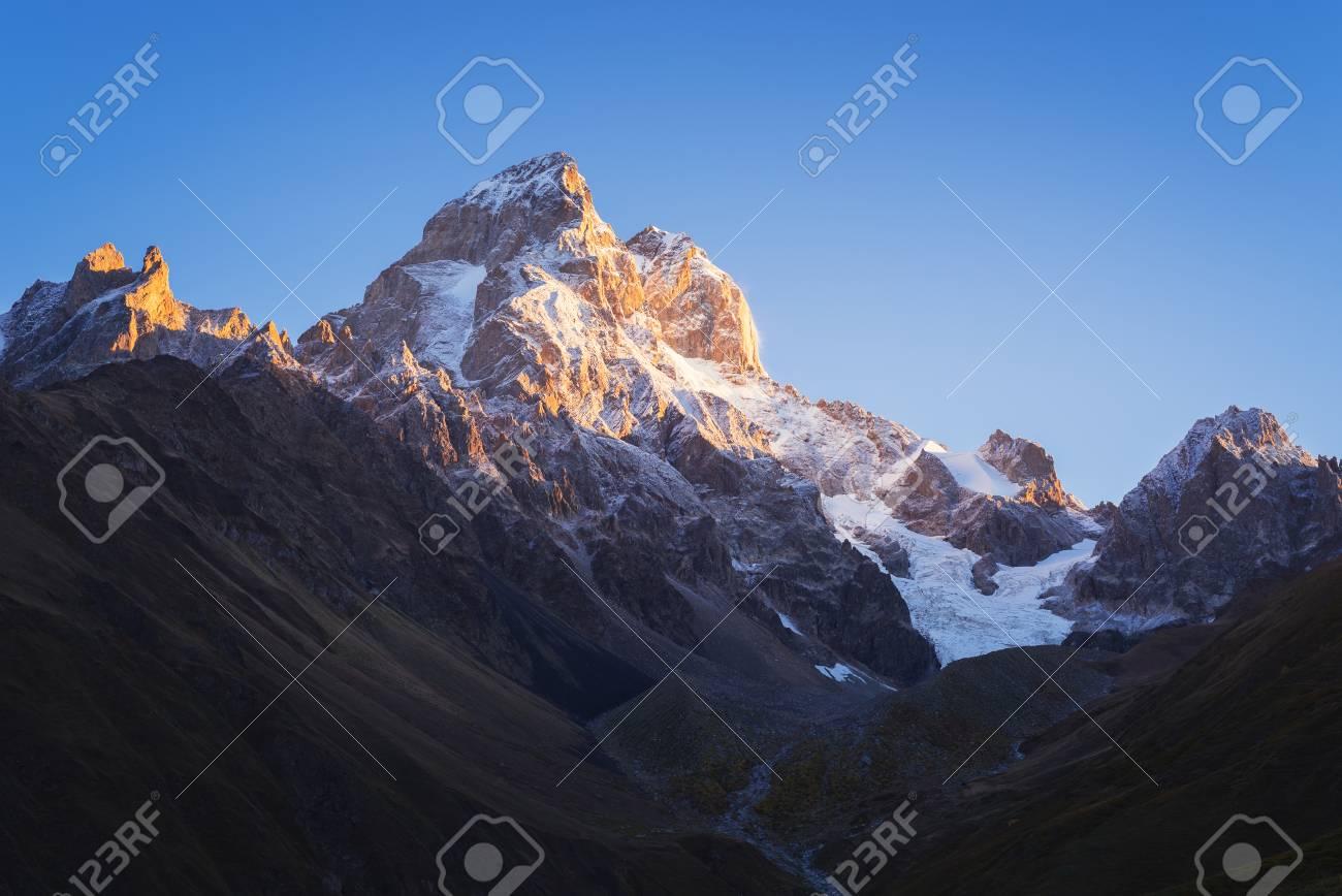 Most beautiful mountain in the Caucasus. Top of Ushba at dawn. Pure morning sky. Beauty in nature. Main Caucasian ridge. Zemo Svaneti, Georgia - 61560852