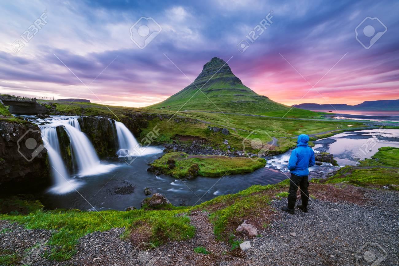 Kirkjufellsfoss waterfall and kirkjufell mountain a tourist stock kirkjufellsfoss waterfall and kirkjufell mountain a tourist tourist attraction near the city of grundarfjordur altavistaventures Images