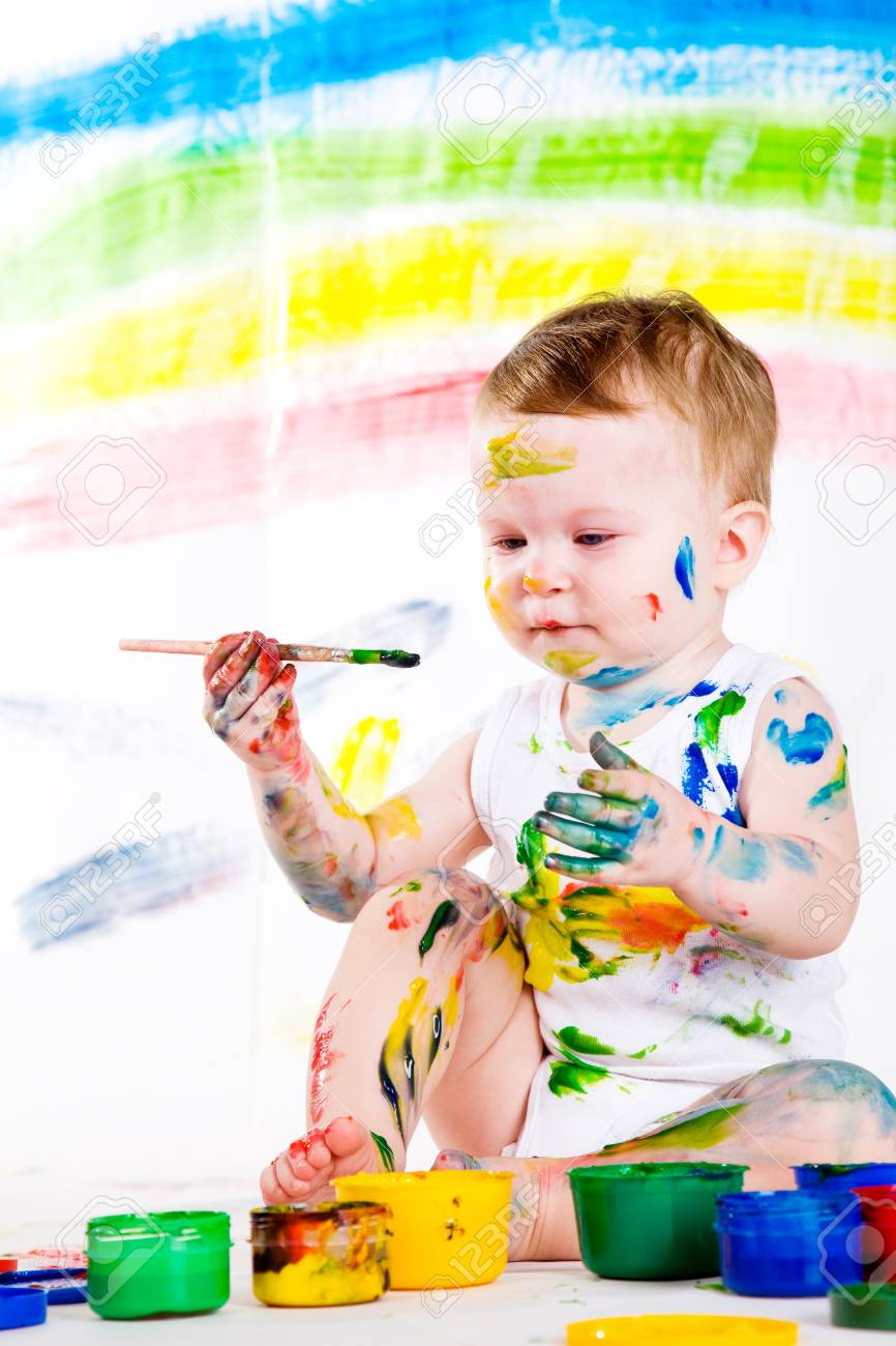 little girl bedaubed with bright colors Stock Photo - 9060310