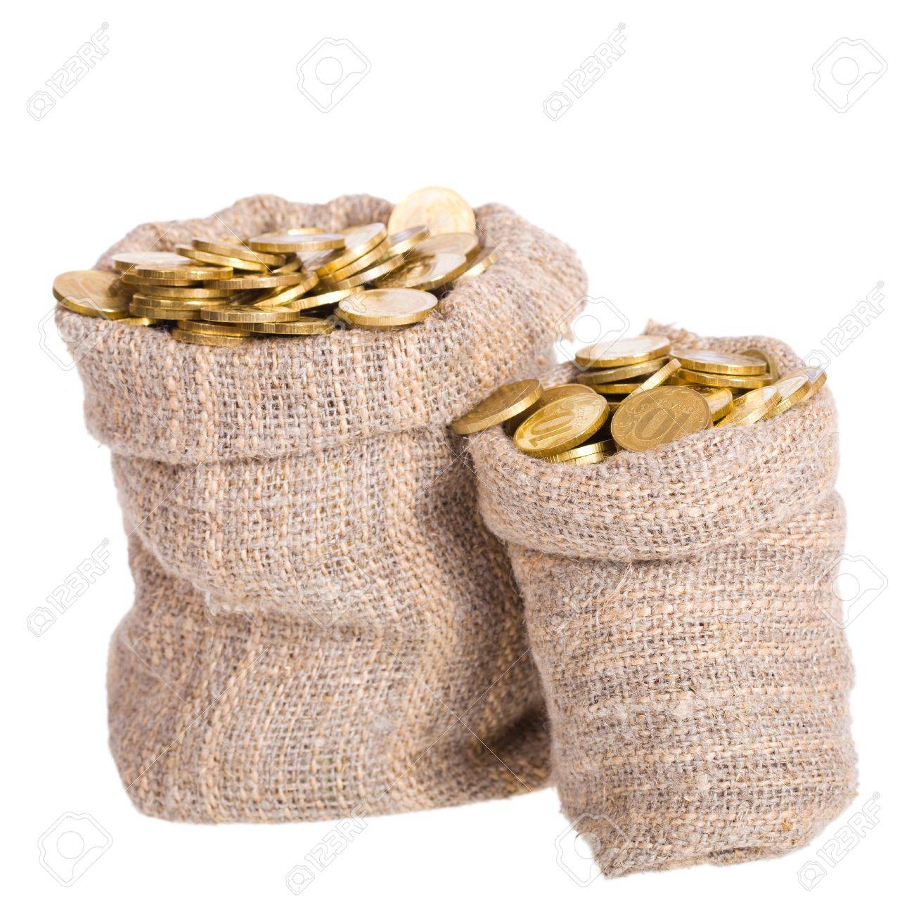 Bags filled with coins. A white background. Isolated. Stock Photo - 9139152