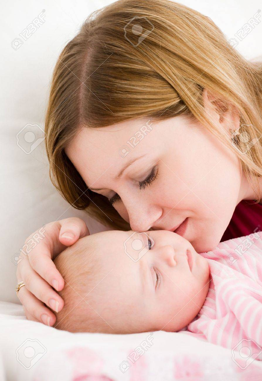 Young mum embraces the falling asleep chest baby Stock Photo - 9958592
