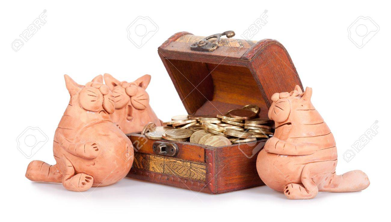 Three cats stand near to a chest full of money. Inheritance section Stock Photo - 12301859