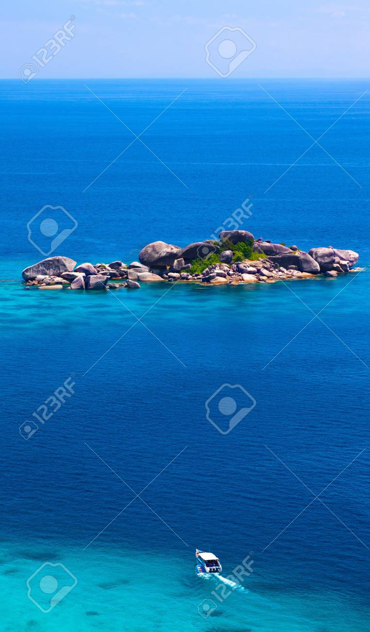 Beautiful sea landscape with tropical coast and the high-speed boat, standing near the shore Stock Photo - 18573257