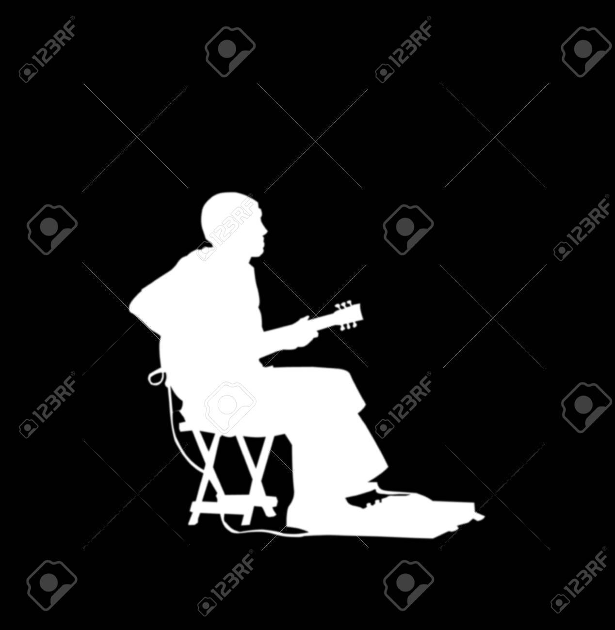 White silhouette, on black, of a street guitar player, with amp and pedals Stock Photo - 5326661