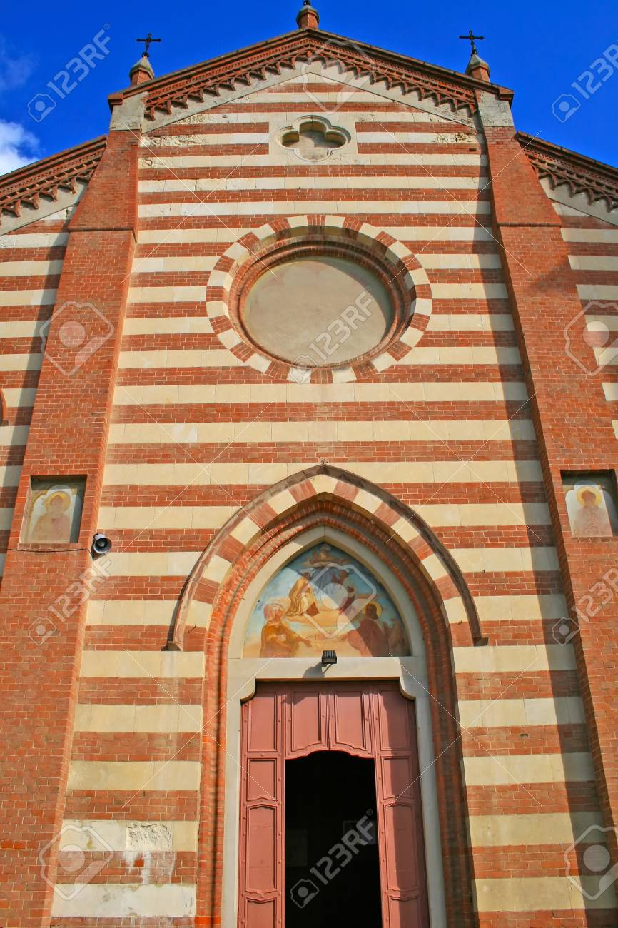 Façade of a romanic church, with red and white stone Stock Photo - 8061211