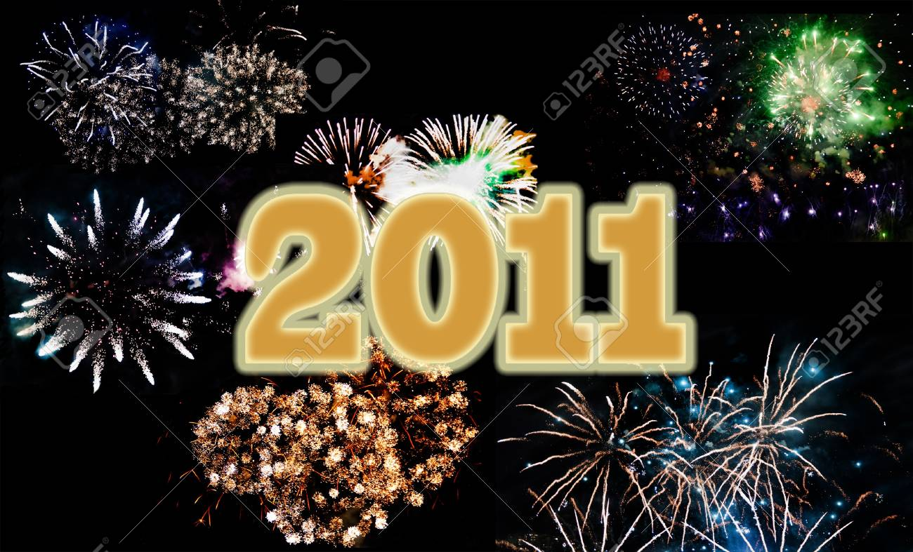 Multicolor fireworks celebrating New Year 2011, written in golden Stock Photo - 8295002