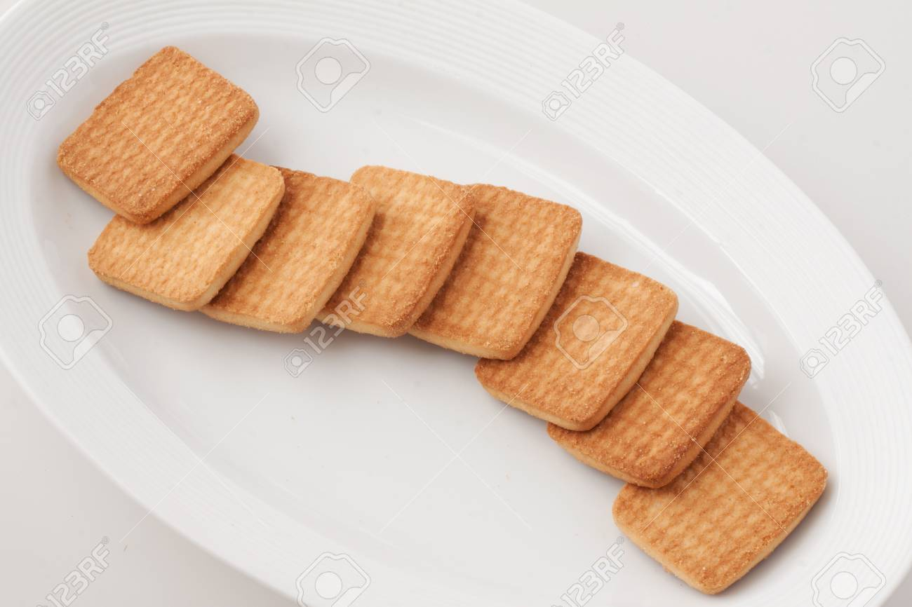 Long Stack Of Biscuits Over A White Plate Stock Photo Picture And