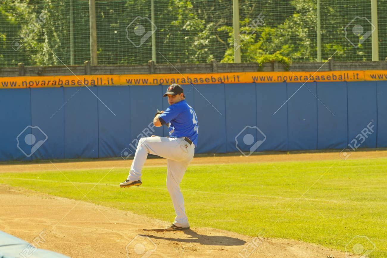 NOVARA, ITALY - JULY 7: Baseball game Novara (blue)-Bologna (purple) 1-17, Italian Serie A. Novara pitcher Sergio Tardivo warms up in the bullpen. July 7, 2012 Stock Photo - 14443532