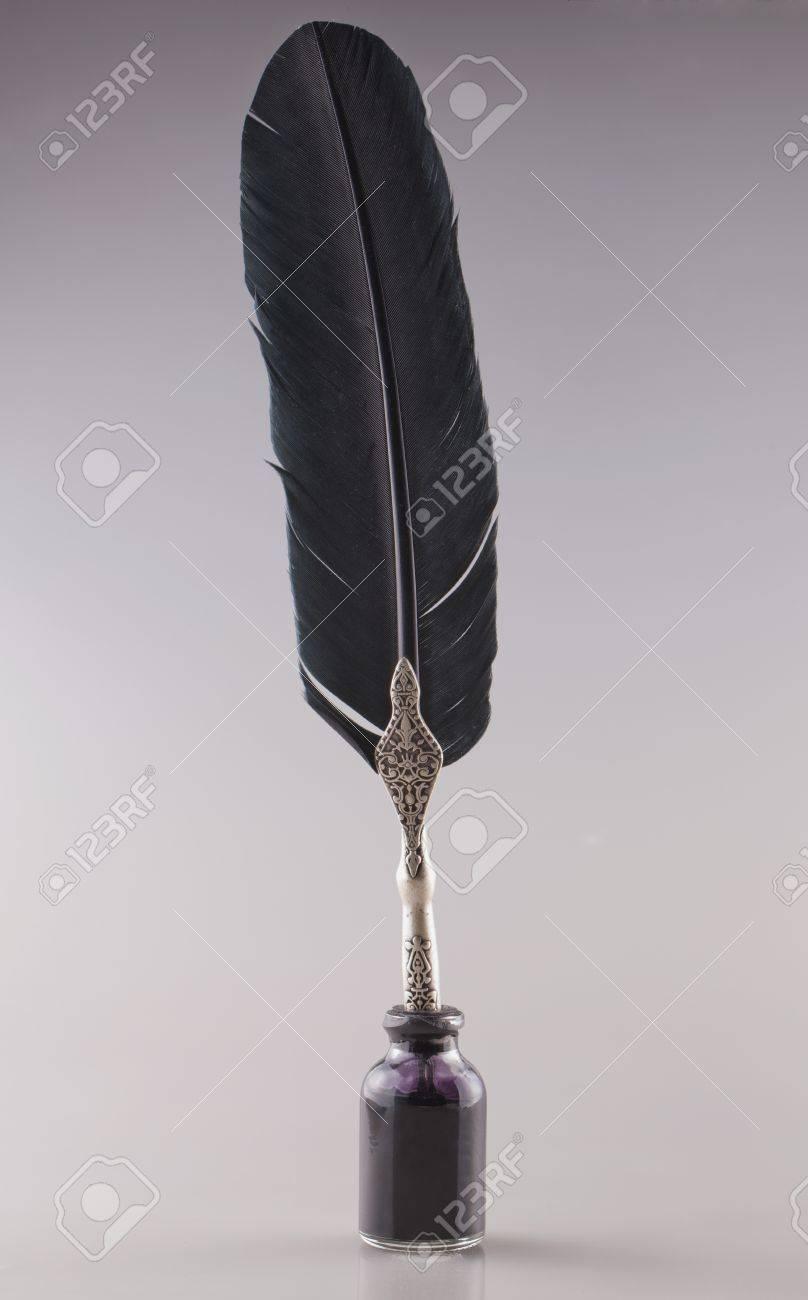 Old pen inside a bottle of black ink Stock Photo - 17038435