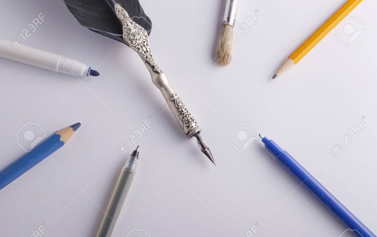 Different tools for writing and drawing, over a white sheet Stock Photo - 17123086