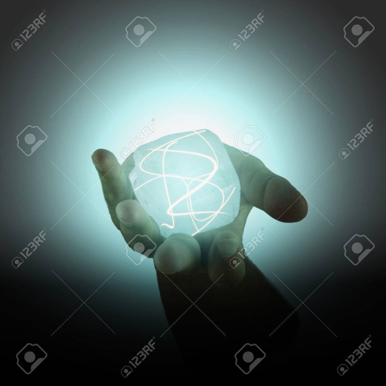 Power cube with lights held in a male hand Stock Photo - 22414652