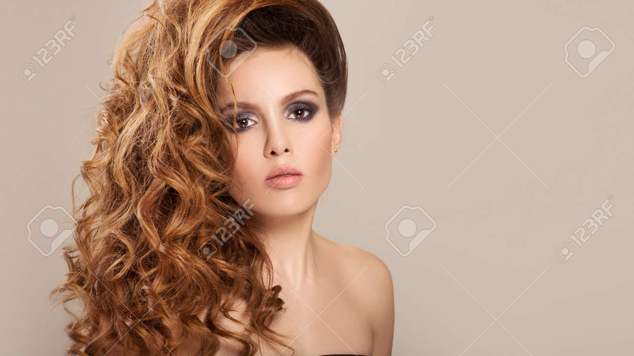Portrait of a pretty woman with long hair and make-up. - 120888835