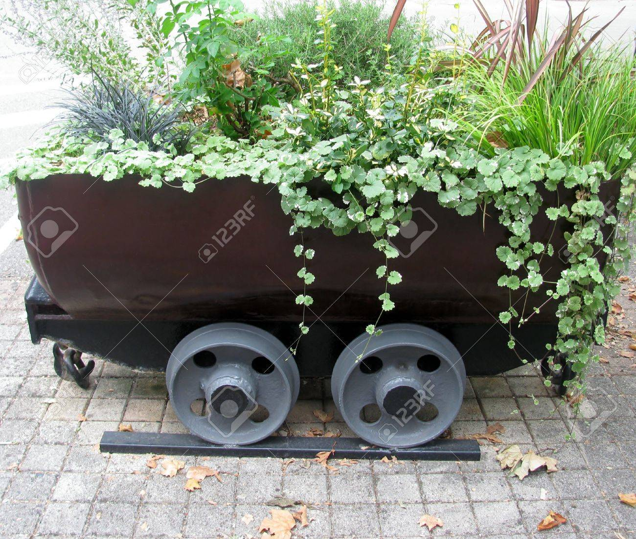 Old Mine Cart For Carrying Rocks As A Decorative Flower Pot Stock ...