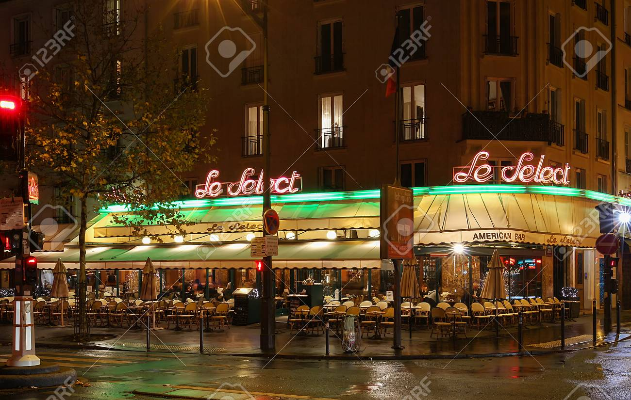 The typical parisian cafe le select decorated for christmas in