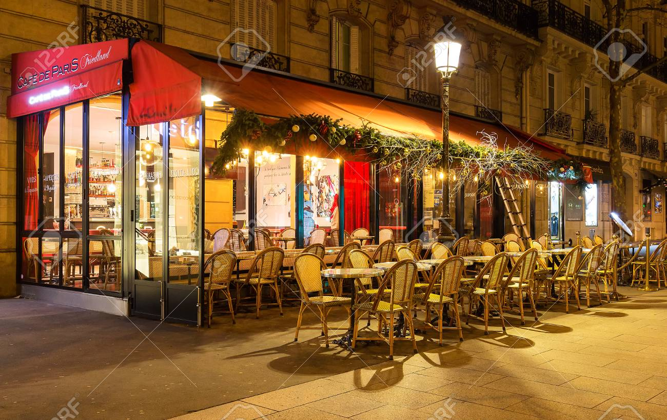 Christmas Paris France.The Traditional French Cafe De Paris Decorated For Christmas