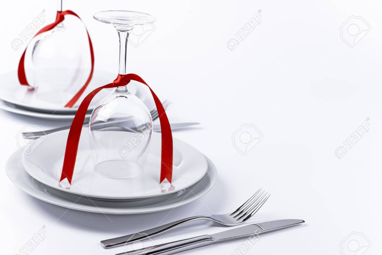 Wine Glasses Turned Upside Down With Red Decoration As Background