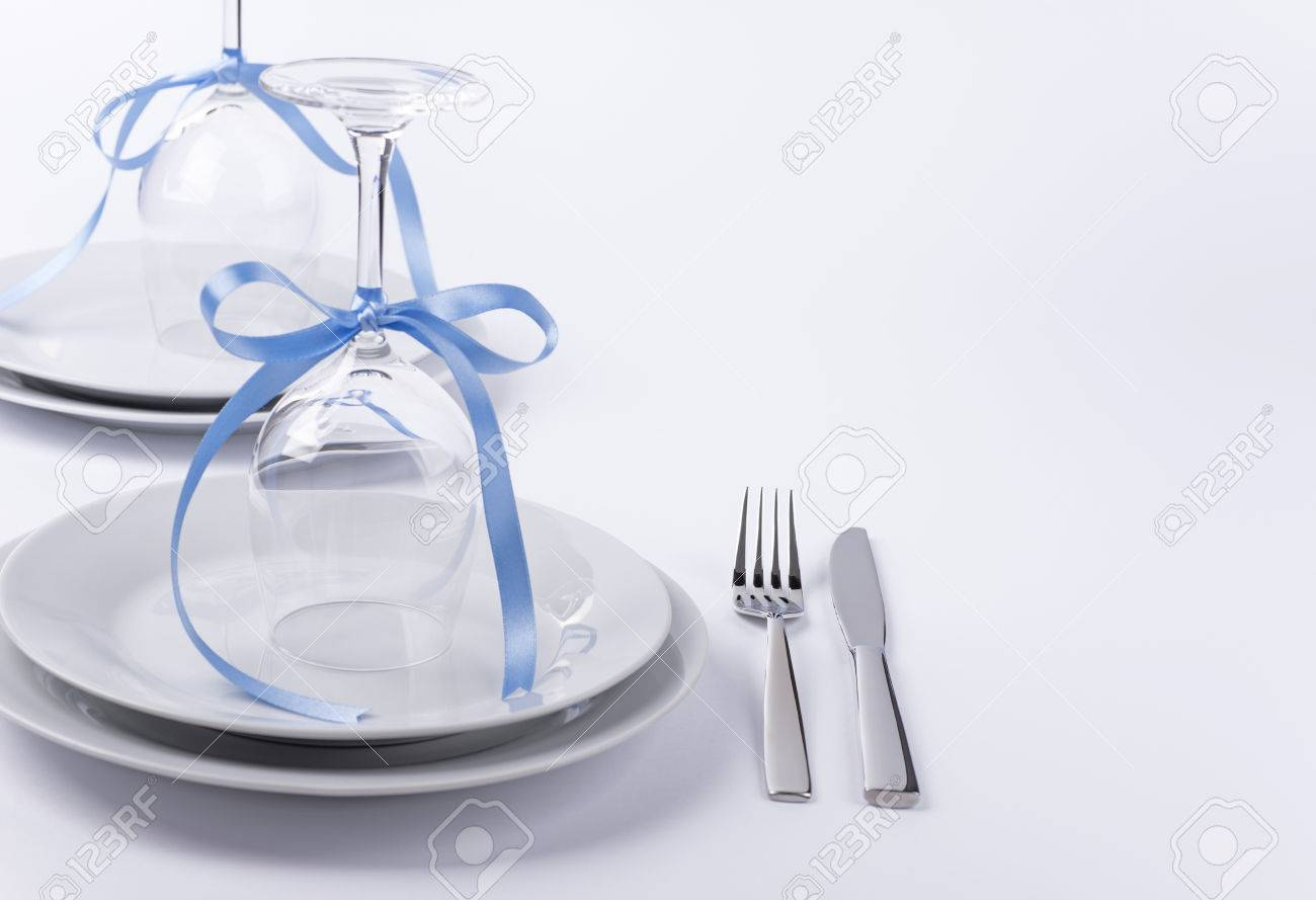 Wine Glasses Turned Upside Down With Blue Decoration As Background